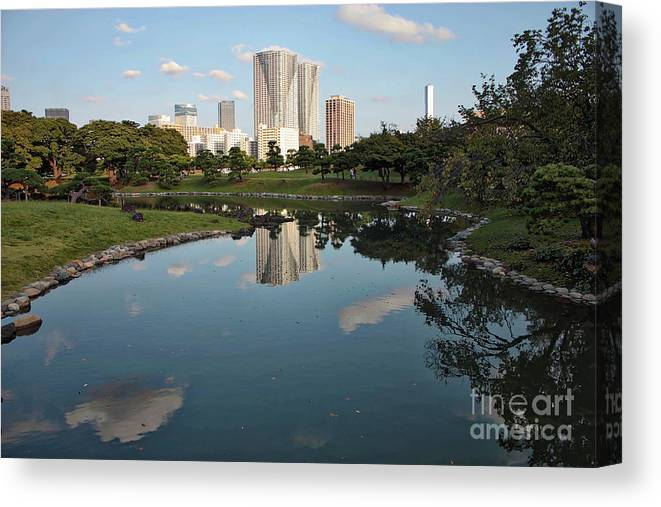 Tokyo Canvas Print featuring the photograph Tokyo Buildings And Garden Pond by Carol Groenen
