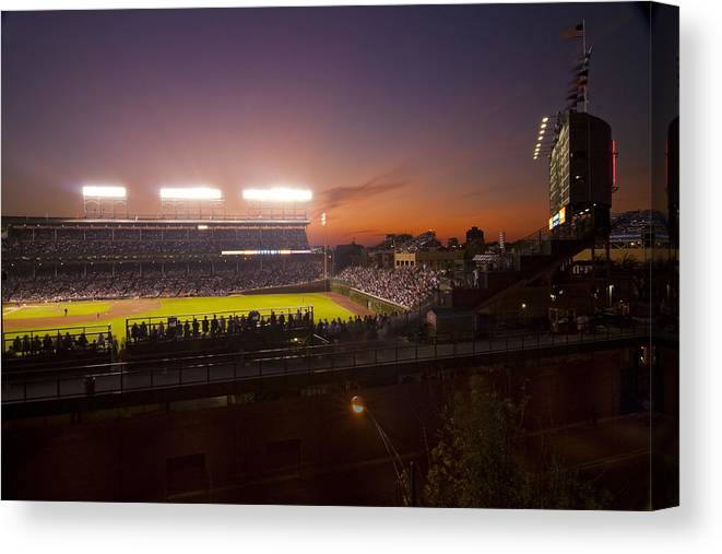 Cubs Canvas Print featuring the photograph Wrigley Field At Dusk by Sven Brogren