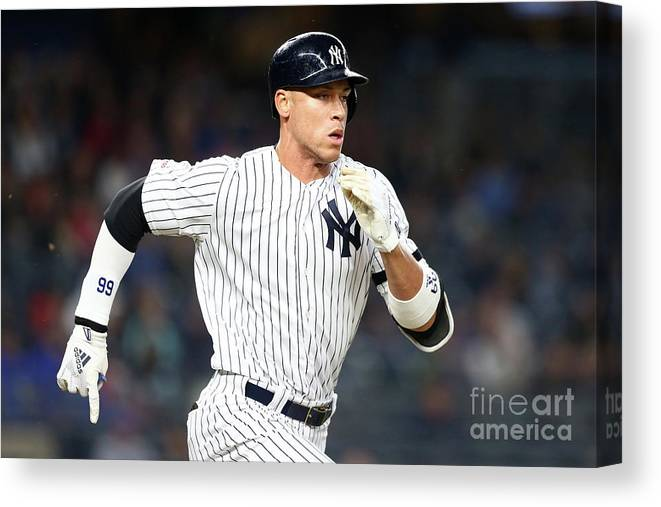 Three Quarter Length Canvas Print featuring the photograph Kansas City Royals V New York Yankees 1 by Mike Stobe