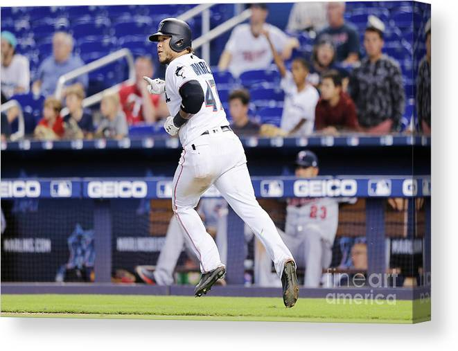 American League Baseball Canvas Print featuring the photograph Minnesota Twins V Miami Marlins 4 by Michael Reaves