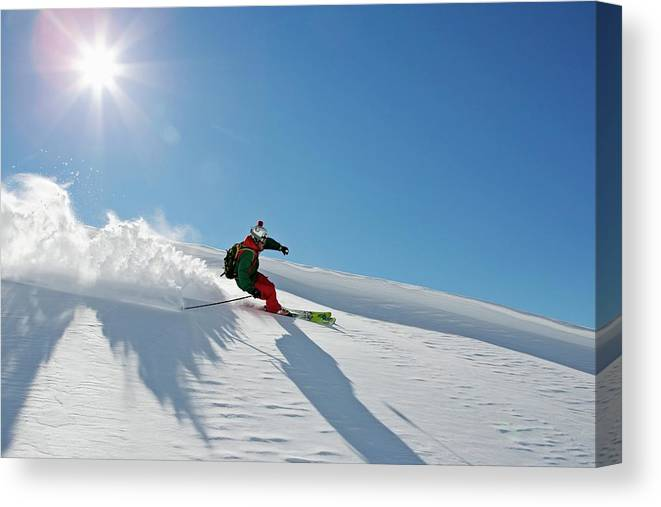 Ski Pole Canvas Print featuring the photograph A Young Skier, A Freerider Making A by Bernard Van Dierendonck / Look-foto
