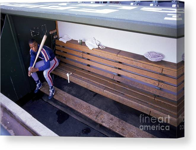 People Canvas Print featuring the photograph Darryl Strawberry Sits In The Dugout by Jonathan Daniel