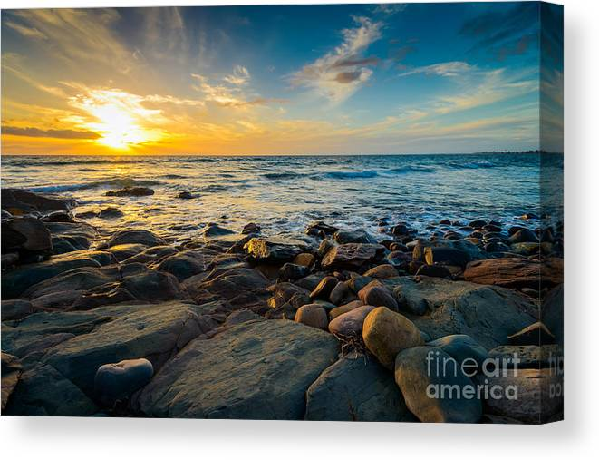 Sunshine Canvas Print featuring the photograph Dramatic Sunset On The Rocky Beach by Amophoto au
