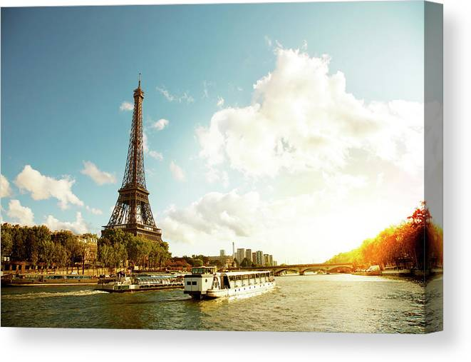 Arch Canvas Print featuring the photograph Eiffel Tower And The River Seine by Vintagerobot