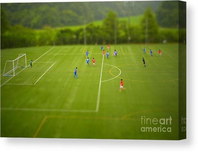 Play Canvas Print featuring the photograph Football Tilt-shift by Jppressmura