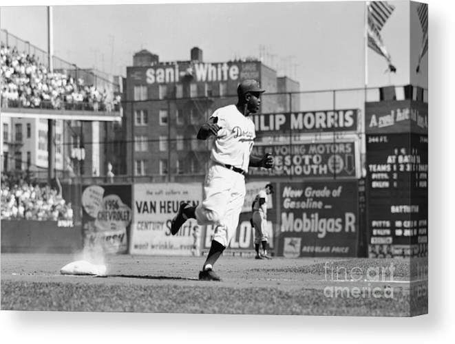 1950-1959 Canvas Print featuring the photograph Jackie Robinson Rounds The Bases by Robert Riger