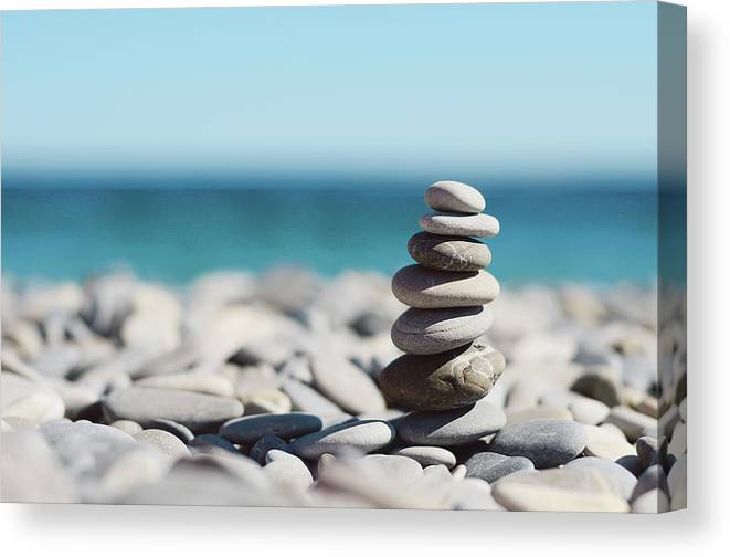 French Riviera Canvas Print featuring the photograph Pile Of Stones On Beach by Dhmig Photography