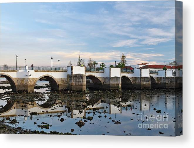 Portugal Canvas Print featuring the photograph The Antique Bridge Of Tavira. Portugal by Angelo DeVal