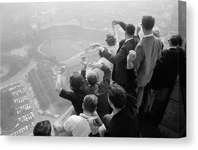 Timeincown Canvas Print featuring the photograph Univ. Of Pittsburgh Students Cheering Wi by George Silk