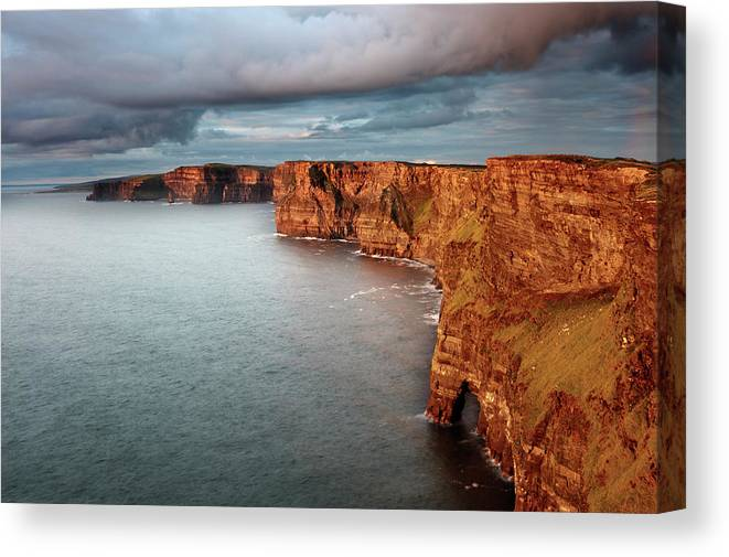 Scenics Canvas Print featuring the photograph Waves Washing Up On Rocky Cliffs by George Karbus Photography