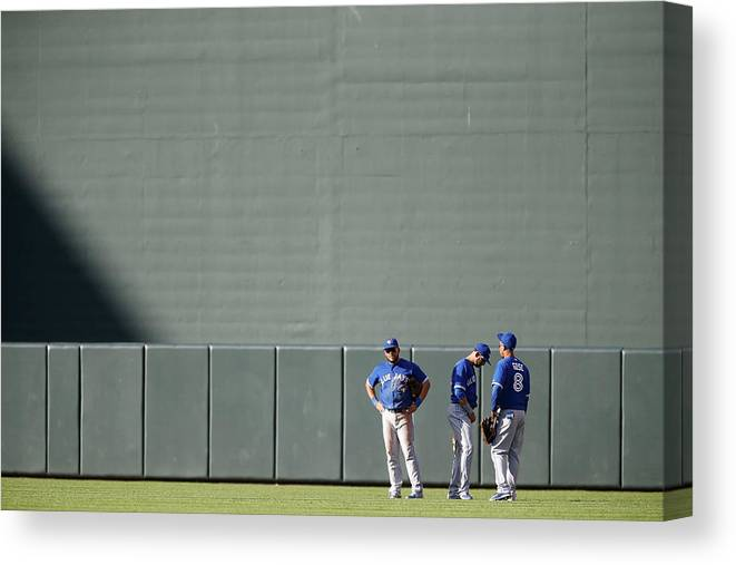American League Baseball Canvas Print featuring the photograph Anthony Gose And Melky Cabrera by Jonathan Ernst