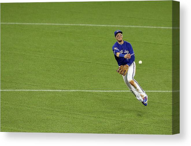 American League Baseball Canvas Print featuring the photograph Ben Zobrist And Troy Tulowitzki by Vaughn Ridley