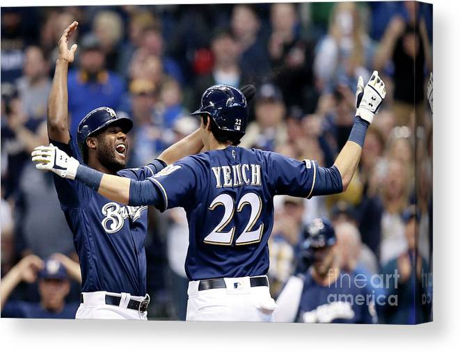 People Canvas Print featuring the photograph Christian Yelich And Lorenzo Cain by Dylan Buell