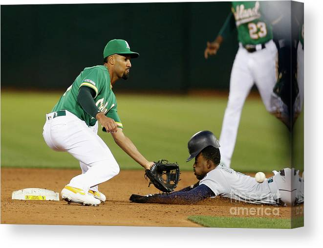 People Canvas Print featuring the photograph Dee Gordon And Marcus Semien by Lachlan Cunningham