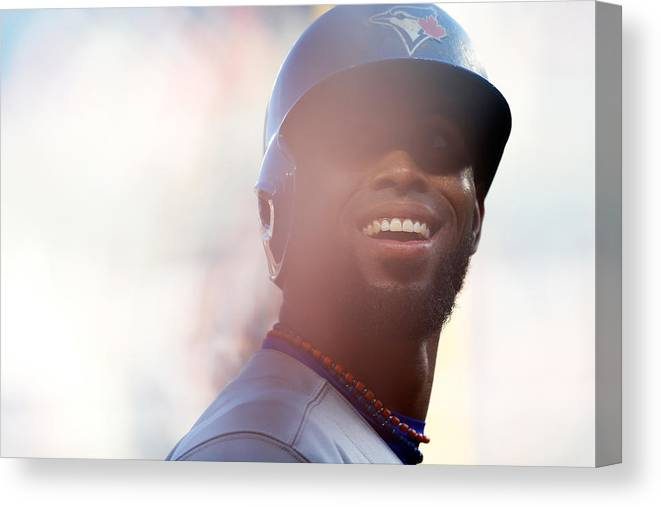 American League Baseball Canvas Print featuring the photograph Jose Reyes by Mike Stobe