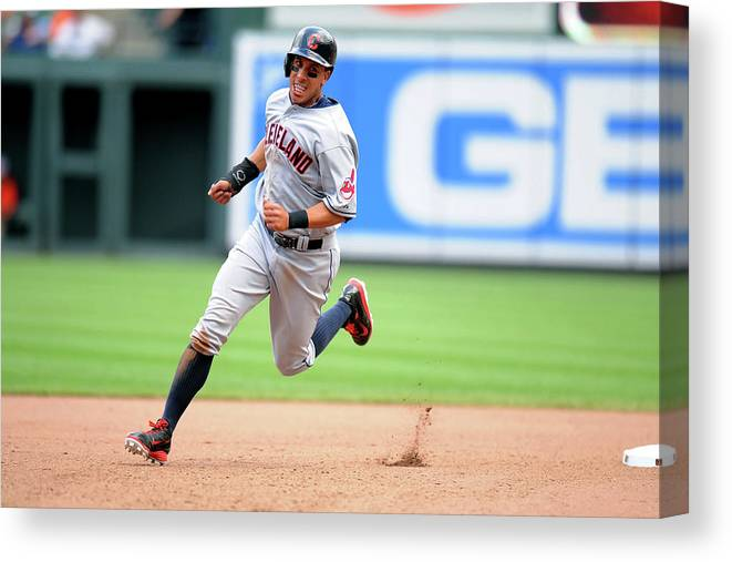 American League Baseball Canvas Print featuring the photograph Michael Brantley And Lonnie Chisenhall by Mitchell Layton