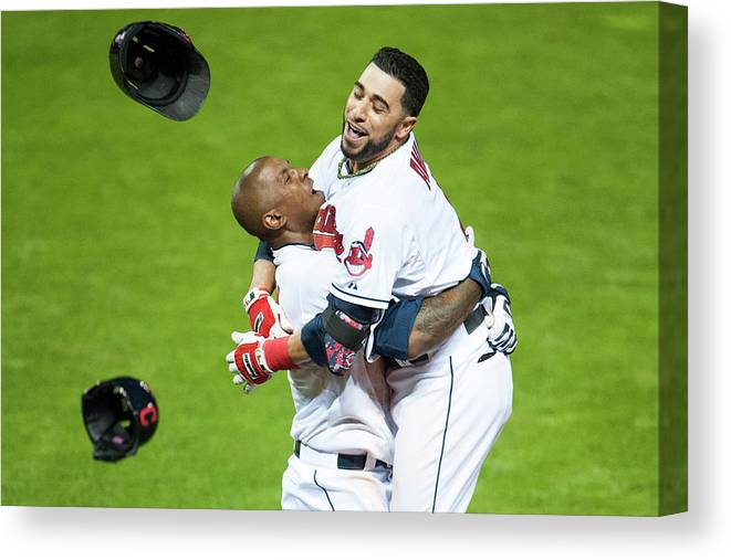 American League Baseball Canvas Print featuring the photograph Nyjer Morgan And Mike Aviles by Jason Miller
