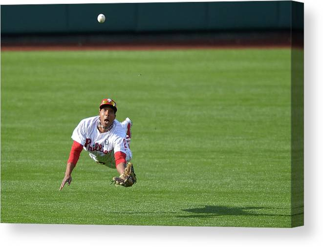 Ball Canvas Print featuring the photograph Scooter Gennett And Ben Revere by Drew Hallowell