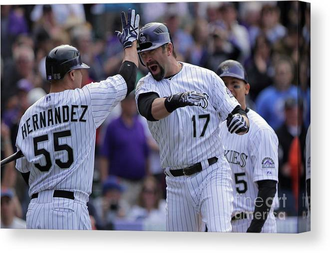 Relief Pitcher Canvas Print featuring the photograph Todd Helton And Ramon Hernandez by Doug Pensinger