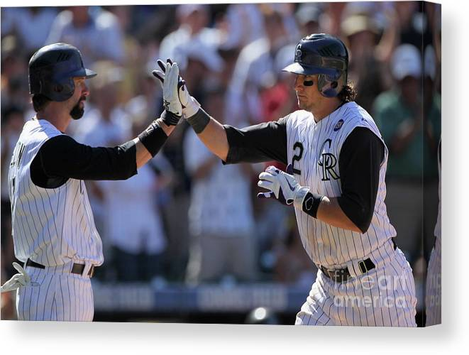 People Canvas Print featuring the photograph Todd Helton, Troy Tulowitzki, And Bill Bray by Doug Pensinger