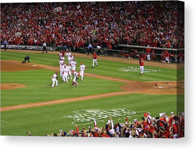 St. Louis Cardinals Canvas Print featuring the photograph Yadier Molina And Jason Motte by Dilip Vishwanat
