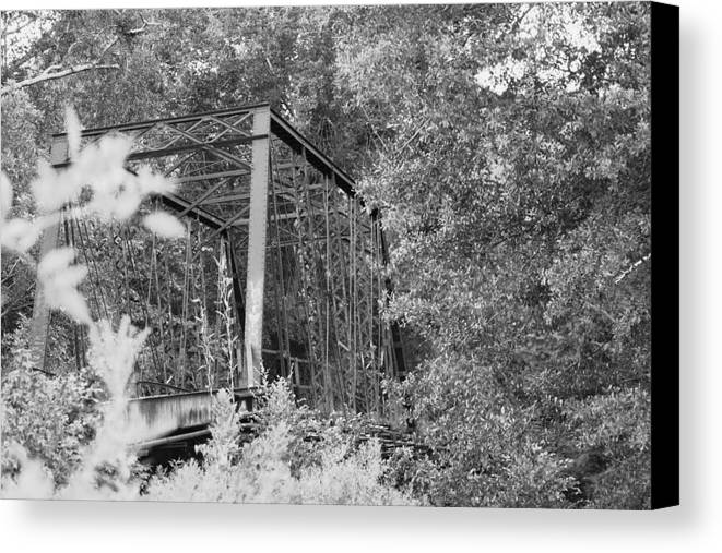 Bridge Canvas Print featuring the photograph Bridge In Black And White by Lisa Johnston