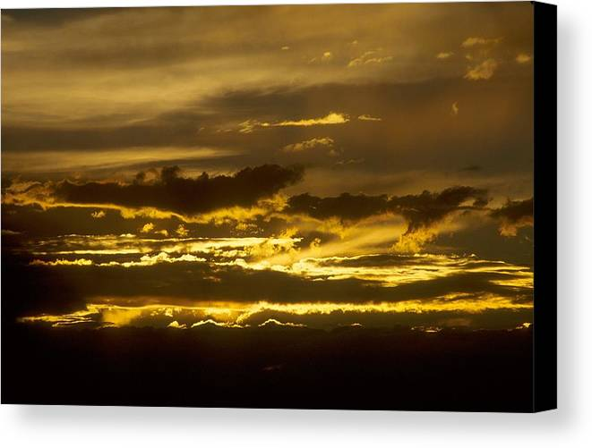 Clouds Canvas Print featuring the photograph Fire In The Sky by Lynard Stroud