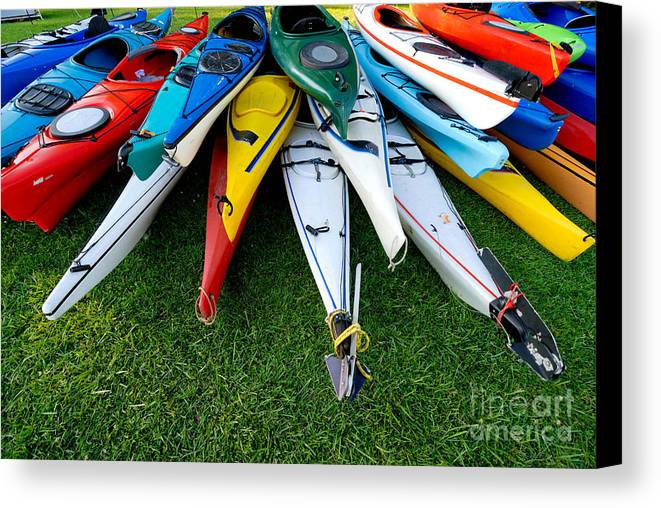 A Lot Canvas Print featuring the photograph A Stack Of Kayaks by Amy Cicconi