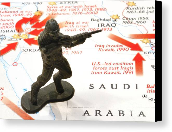Aggression Canvas Print featuring the photograph Army Man Standing On Middle East Conflicts Map by Amy Cicconi