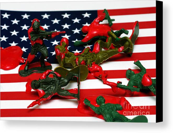 Against The War Canvas Print featuring the photograph Fallen Toy Soliders On American Flag by Amy Cicconi