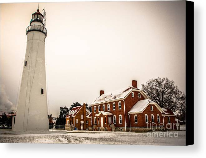 Ft. Gratiot Lighthouse Canvas Print featuring the photograph Fort Gratiot Lighthouse In Winter by Grace Grogan