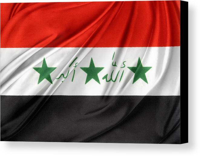 Banner Canvas Print featuring the photograph Iraq Flag by Les Cunliffe