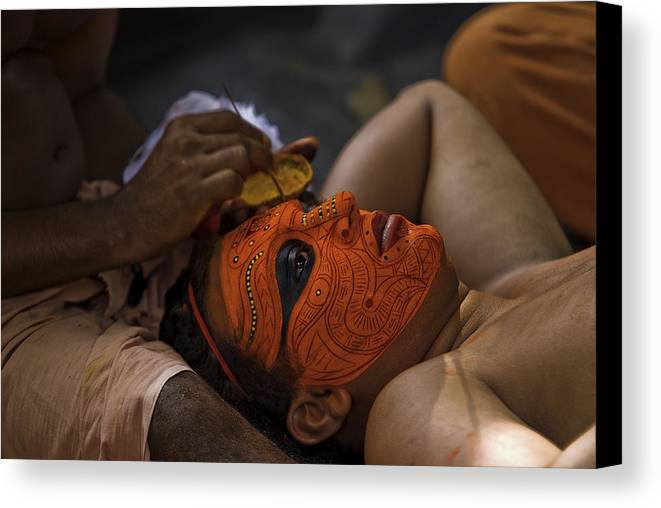 Chuzhali Bhagavathi Canvas Print featuring the photograph Kerala - A Theyyam-dancer Receives The Ornamental Face-painting by Urs Schweitzer