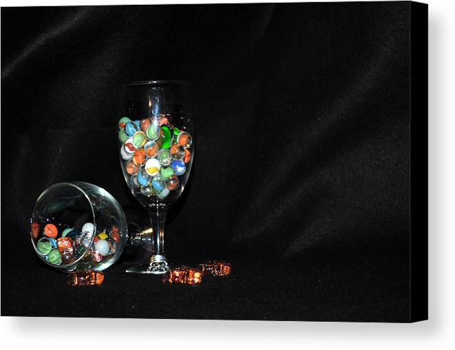Marbles Canvas Print featuring the photograph Marbles And Glass by Cecilia Raza