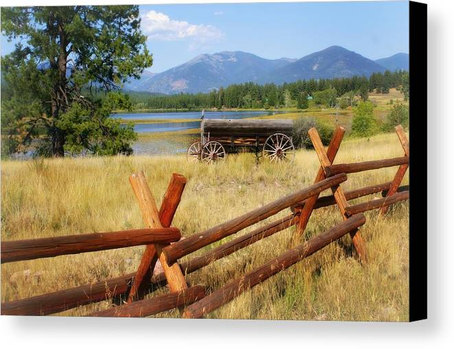 Landscape Canvas Print featuring the photograph Rustic Wagon by Marty Koch