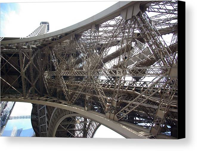 Tour Eiffel Canvas Print featuring the photograph Underneath The Tour Eiffel by Andy Fletcher