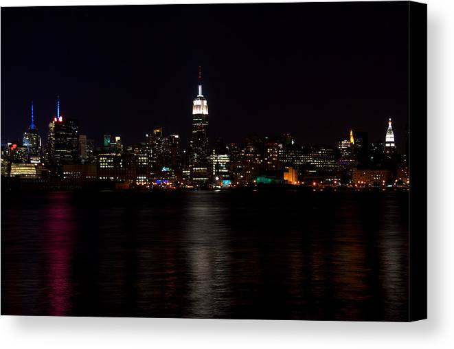 Buildings Canvas Print featuring the photograph Ny At Night by Mike Horvath