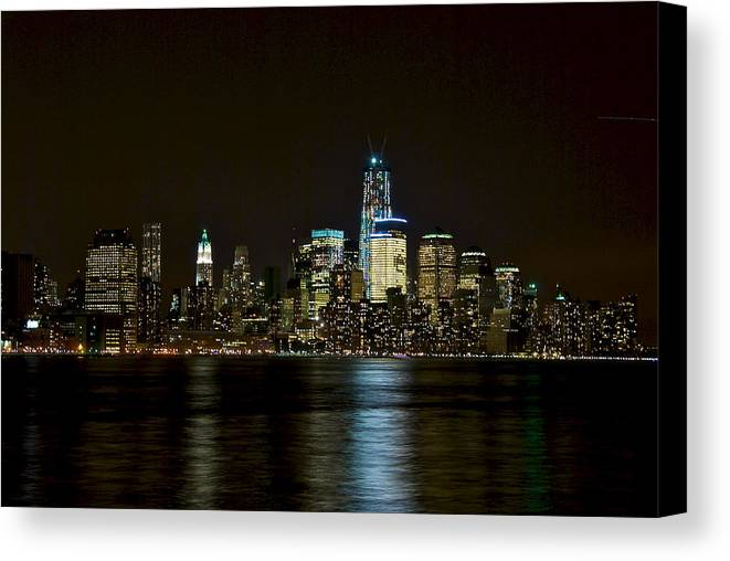 Buildings Canvas Print featuring the photograph NYC by Mike Horvath