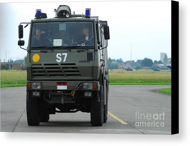 Air Component Canvas Print featuring the photograph A Fire Engine Based At The Air Force by Luc De Jaeger