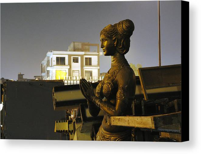 Sculpture Canvas Print featuring the photograph A Trashed Sculpture by Sumit Mehndiratta