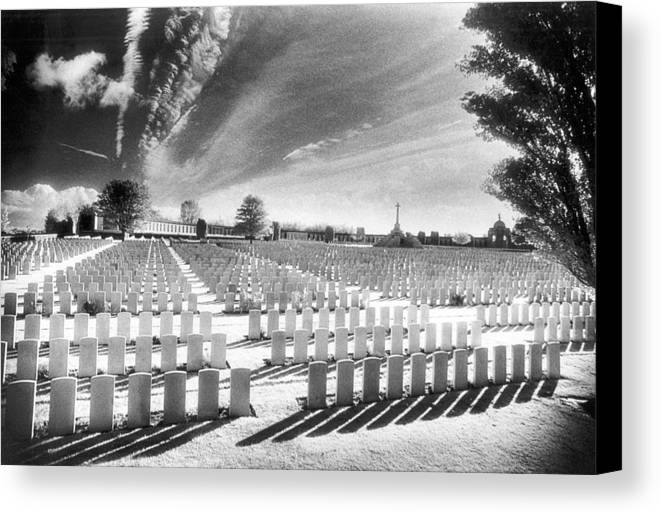 First World War; One; 1; Wwi; Ww1; 1st; I; Graves; Gravestones; Tombstones; Belgian; Commemorative; War Memorial; Vast; Stark; Shadows; Eerie; Atmospheric; Bright; Sunlight; Cross; Rows Canvas Print featuring the photograph British Cemetery by Simon Marsden