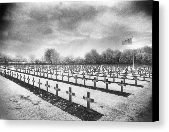 Graves; Graveyard; Gravestones; Belgian; Landscape; Flag; War Memorial; Commemorative; Crosses; Mysterious; Eerie; Atmospheric; Rows; Ominous; Overcast; Great; Wwi; Ww1; One; 1st Canvas Print featuring the photograph French Cemetery by Simon Marsden