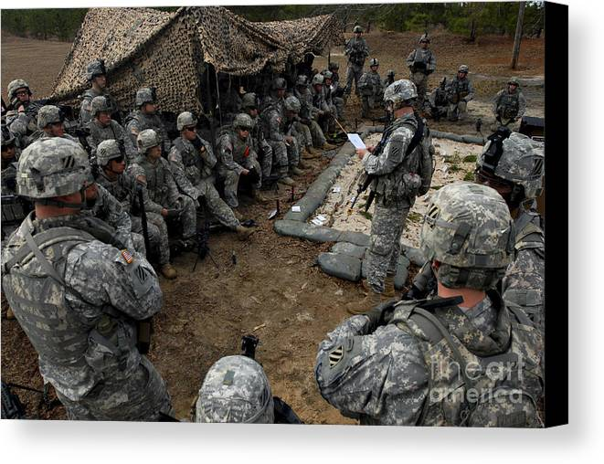 Battalion Canvas Print featuring the photograph Infantrymen Receive Their Safety Brief by Stocktrek Images