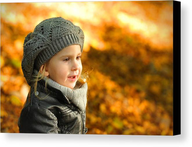 Adorable Canvas Print featuring the photograph Little Girl In Autumn Leaves Scenery At Sunset by Waldek Dabrowski