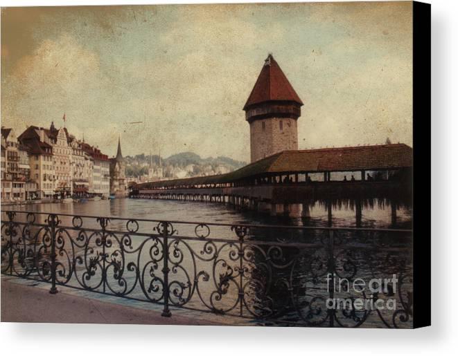 Chapel Bridge Canvas Print featuring the photograph The Chapel Bridge In Lucerne Switzerland by Susanne Van Hulst