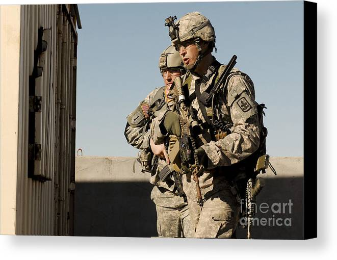 Soldier Canvas Print featuring the photograph U.s. Army Soldiers Search A Site by Stocktrek Images
