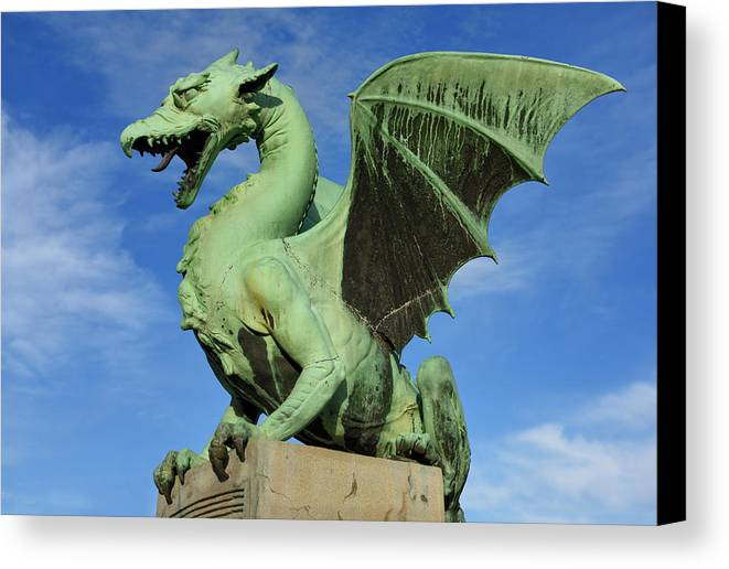 Dragon Canvas Print featuring the photograph Roaring Winged Dragon Sculpture Of Green Sheet Copper Symbol Of by Reimar Gaertner
