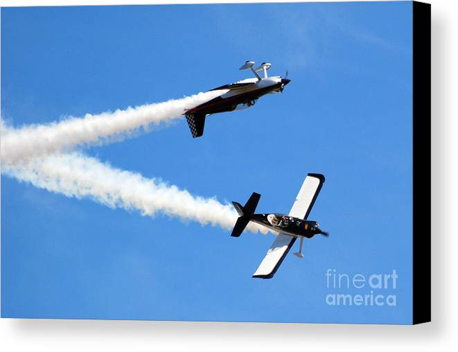 Airplanes Canvas Print featuring the photograph Crossing Paths by Larry Keahey