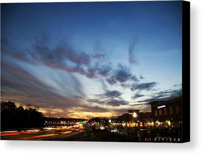 Sky Canvas Print featuring the photograph Divided by Jonathan Ellis Keys