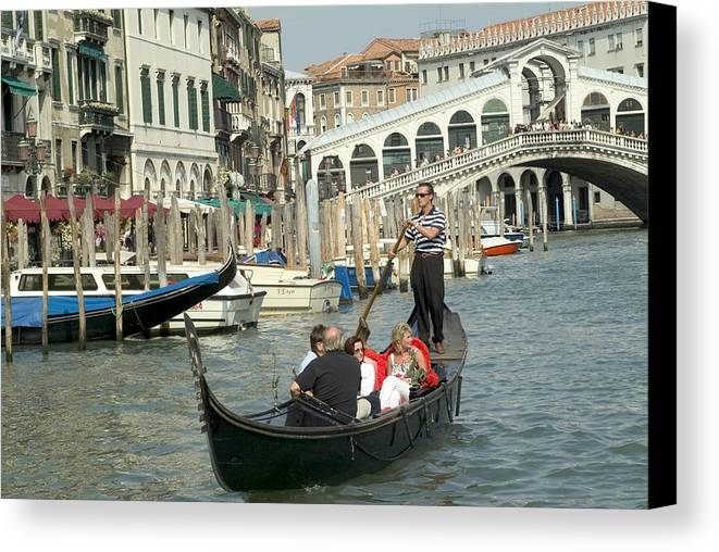 Venice Canvas Print featuring the photograph Gonfolas On Venice Canal At Rialto Bridge by Charles Ridgway